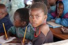 "Zambian children attend school in a poverty stricken area near the country's capital Lusaka July 1, 2005. July 1 was designated ""Whit Band Day"" as campaigners began a week of action aimed at focusing attention on issues of poverty ahead of next weeks meeting of G8 leaders in Gleneagles, Scotland. REUTERS/Salim Henry  SH/AH - RP6DRMVDHNAB"